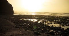 Timelapse sea wave hit the rock at sunset in marocco beach legzira Stock Footage