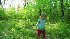 Young Toddler Girl Walking in Green Forest Stock Footage