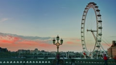 Time lapse of tourists and London eye at dusk Stock Footage
