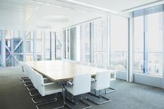 Empty meeting table in office - stock photo