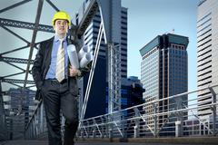 Architect in protective helmet speaking by phone Stock Photos