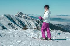 Stock Photo of Happiness female at ski stay on the beautiful mountains view