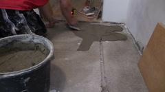 Handyman worker trowel spreading mortar for ceramic tile stick Stock Footage