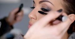 Beautician applying mascara Stock Footage
