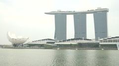 Singapore Marina Bay Sands w Arts & Science Museum across bay Stock Footage