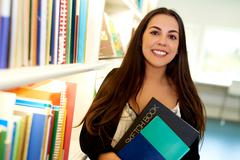 Happy young art student at the college library Stock Photos