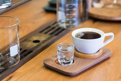 cup of black coffee drip soda short - stock photo