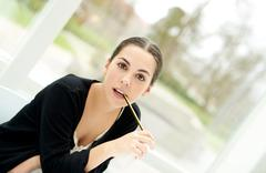 Intense young businesswoman staring at the camera Stock Photos