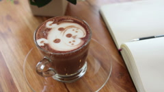 Zoom in  a cup of art latte at coffee shop, shape of a bear Stock Footage