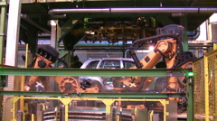 Robots weld car parts in production line Stock Footage