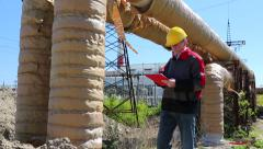 Service engineer at heat electropower station - stock footage