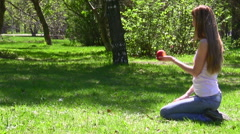 The woman gives apple to the little girl Stock Footage