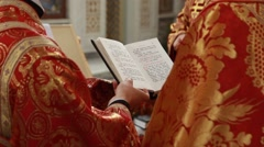 Close up of priest reading the holy bible with rosary Stock Footage