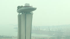 Singapore Marina Bay Sands mid-rise w port cranes high angle - stock footage
