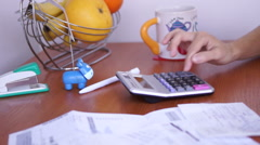 Calculating Bills On The Kitchen Table With Sound Stock Footage