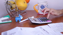 Calculating Bills On The Kitchen Table Stock Footage