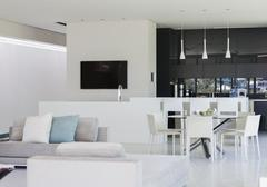 Sofa and dining table in modern living space Stock Photos