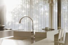 Faucet and sink in modern kitchen Stock Photos