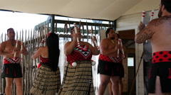 Maori performance in Whakarewarewa thermal valley in Rotorua New Zealand Stock Footage