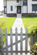 white picket fence and an entrance - stock photo