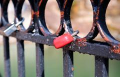 Locks on the metal fence Stock Photos