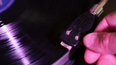 DJ placing needle on vinyl, close shot hand. Stock Footage