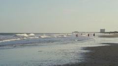 People on South Carolina beach Stock Footage