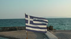 Greek flag next to the sea. Stock Footage