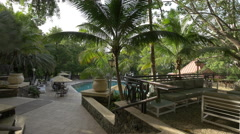 Going down the stairs to the pool at Karibe Hotel, Haiti - stock footage