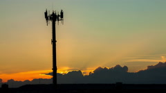 Communication tower with a sunset timelapse in background Stock Footage