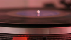 Turntable spinning, side view, red hue. Stock Footage