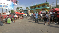 Woman carrying a bag on her head in Haiti - stock footage