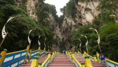 Batu Caves entrance from middle of staircase, stunning limestone arches Stock Footage