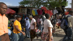 Walking in the street market in Haiti Stock Footage
