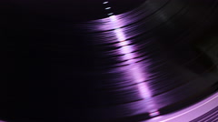 Vinyl spinning on turntable, purple reflection Stock Footage
