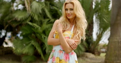 Portrait of Blond Woman in Tropical Location Stock Footage
