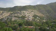 Beautiful view of a hill with houses in Haiti Stock Footage