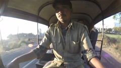 Portrait of rickshaw driver during ride, with road in background, timelapse. Stock Footage
