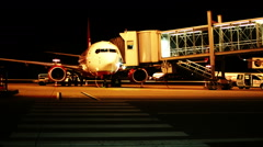 Parked aircraft at night Stock Footage