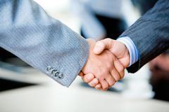Handshake of businesspeople Stock Photos
