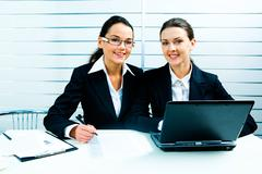 Business ladies at work Stock Photos