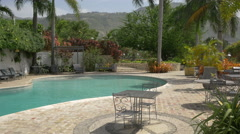 The beautiful pool and garden of the Karibe Hotel in Haiti Stock Footage