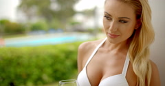 Woman Holding Glass of Red Wine Outdoors near Pool Stock Footage
