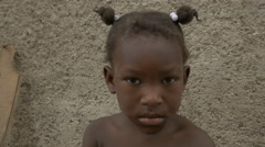 Little girl with ponytails in Haiti - stock footage