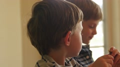 Boys at a birthday party celebration Stock Footage
