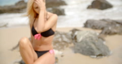 Blond Woman Looking into the Distance on Beach Stock Footage
