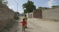 Two Haitian children on the street in Haiti Stock Footage