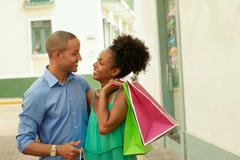 African American Couple Carrying Shopping Bags In Panama City Stock Photos