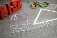 Project triangle - closeup on the resources factor - stock photo