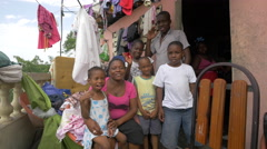 Haitian family waving and smiling in Port-au Prince, Haiti - stock footage